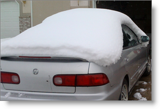 Snow on my car after much of it had melted away